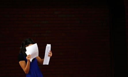 A girl looks at her A-level exam results at Withington Girls School in Manchester