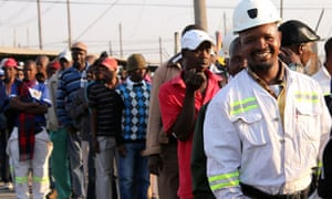 Thousands of Lonmin miners wait in line
