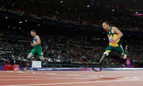 Para1 Alan Fonteles Cardoso Oliveira beats South Africa's Oscar Pistoriu in the men's 200m.
