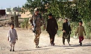 A British soldier of the 2 Scots patrols Helmand's capital, Lashkar Gah, in 2008.
