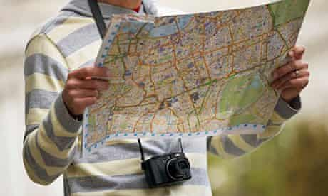 A mid-adult man  looking at a map