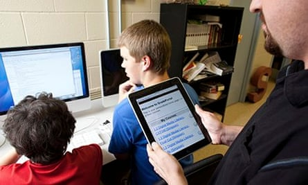 Teacher uses iPad during digital media literacy class at Manor New Tech High School in Manor, Texas