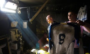 Staff at Beitar Jerusalem clear up on Friday after the arson attack