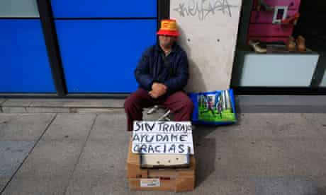 Unemployed Juan Bayes, 60, sleeps as he begs in the Andalusian capital of Seville.