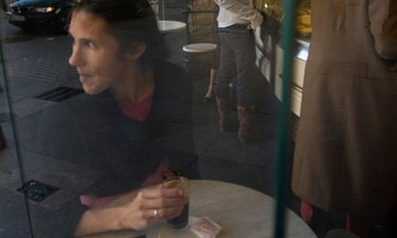 A woman drinking coffee in a cafe in Spain