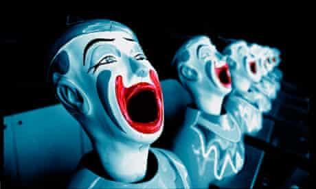 Laughing clowns at a funfair