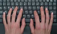 Close Up of a Caucasian Woman Typing on the Keyboard of a Laptop Computer