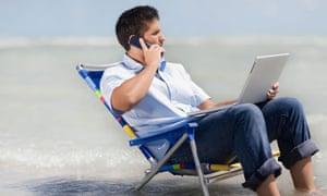 Hispanic man in beach chair with laptop