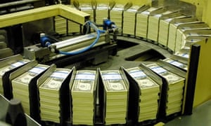 Freshly printed dollar bills in Washington, DC.