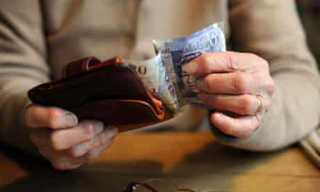 female pensioner holding money in her arthritic hands. Image shot 11/2012. Exact date unknown.