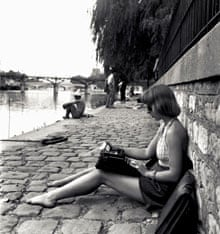 Emma Smith photographed unawares on the banks of the Seine, 1948.