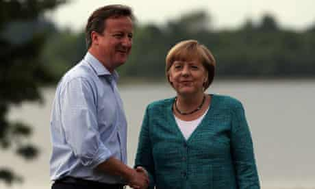 German chancellor Angela Merkel is greeted by David Cameron at the G8 summit in June