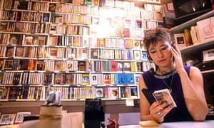 A woman listening to a cassette in the 80s