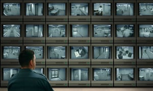 Corporate security center observing employees via video surveillance television monitors and cameras