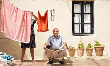 Couple on Patio with Newspaper and Laundry