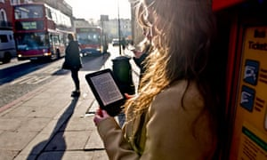 A woman with an e-reader on a London street