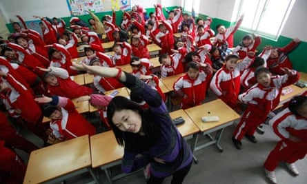 A teacher leads her students doing body exercise