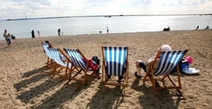People sit in deckchairs on the beach at Southend, Essex. It is (allegedly) the new cool place to live.