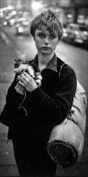 Girl holding a kitten by Bruce Davidson