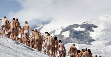 Naked volunteers pose for Spencer Tunick in the Swiss glacier of Aletsch