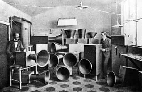 Luigi Russolo (1885 - 1947) the futurist artist with his assistant