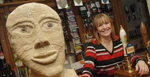 Fiona Gould with one of the Yorkshire stone heads