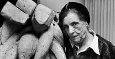 Louise Bourgeois with one of her sculptures, Baroque (1970)