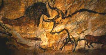 A replica of the Lascaux cave painting of a bull and a horse