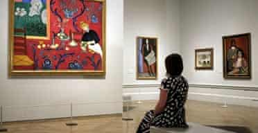 From Russia, Royal Academy: A visitor looks at The Red Room (Harmony in Red) by Matisse