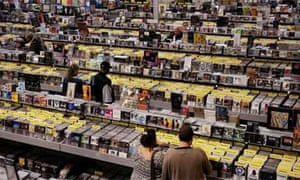 People browse through CDs at Amoeba records in Hollywood, Los Angeles, where the popularity of downloading hasn't completely killed the CDs market. music store record shop. Photograph: Sarah Lee
