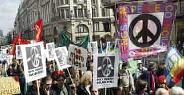 CND logo -  Campaigners for nuclear disarmament (CND) take part in a demonstration march