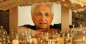 Frank Gehry with his designs for the Serpentine Gallery Pavilion