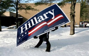 A man carries a sign for New York Senator and Democratic presidential hopeful Hillary Clinton through the sign before her arrival to a polling site at a school in Concord, New Hampshire, USA, 08 January 2008
