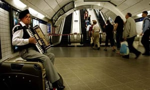 Leslie Horton, accordion player and busker in a London Underground tube station