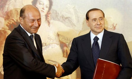 Traian Basescu and Silvio Berlusconi shake hands after a joint press conference at Chigi Palace