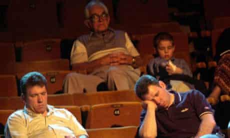 An audience sleeps