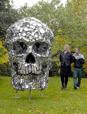 "Visitors to the sculpture park of the Frieze Art Fair in Regents park in London, view Subodh Gupta's sculpture ""Mind shut down"""