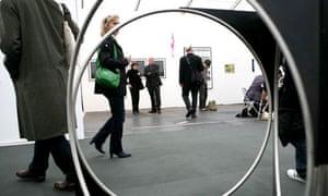 Visitors pass Nicole Wermers' Spa 11 at the 2008 Frieze Art Fair