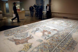 Byzantium at the Royal Academy: Visitors to the Royal Academy of Arts look over part of the mosaic pavement with personifications of the months (6th Century)