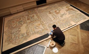 Byzantium at the Royal Academy:  A technician works on re-assembling part of a mosaic pavement with personifications of the months from the early sixth century