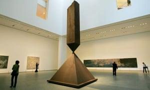 Visitors walk around a sculpture by Barnett Newman entitled Broken Obelisk, on display at MoMa