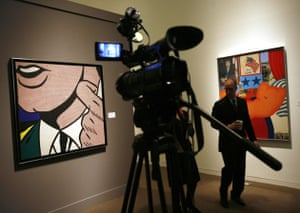 Tom Wesselmann's Great American Nude #21 (R) and Roy Lichtenstein's Half Face with Collar,1963, are seen during a press preview at Sotheby's in New York October 29, 2008