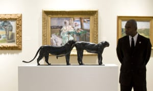 A security guard looks at Deux Grands Leopards by Rembrandt Bugatti during a press preview October 29, 2008 at Sotheby's in New York
