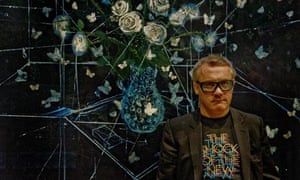 Damien Hirst stands in front of White Roses and Butterflies (2008), at No Love Lost – Blue Paintings