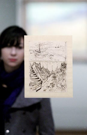 A visitor looks at a drawing by Vincent van Gogh at an exhibition of his letters and sketches
