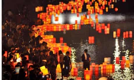 Paper lanterns are floating in Hiroshima, western Japan