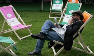 A reader at the Guardian Hay Festival 2007 in a Penguin deckchair