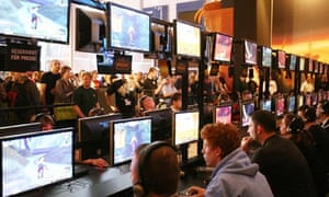 People play with new video games on disp