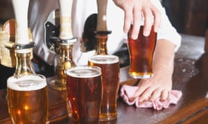 Pints of beer on a bar in a pub
