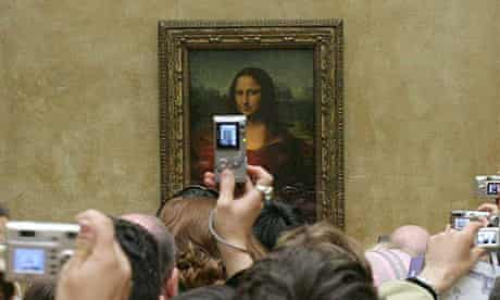 Mona Lisa at the Louvre with tourist photographers.